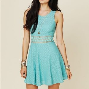 Fitted with Daisies fit and flare dress in Seafoam